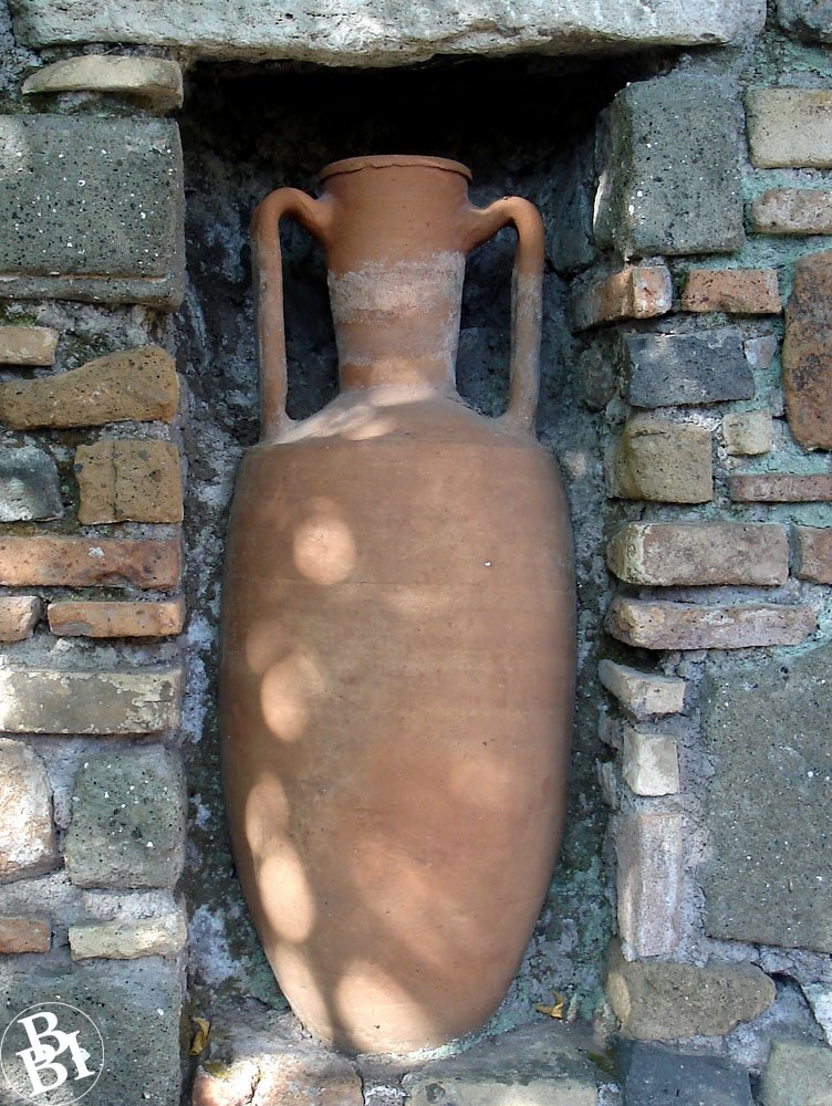 Old Roman jug in a wall recess