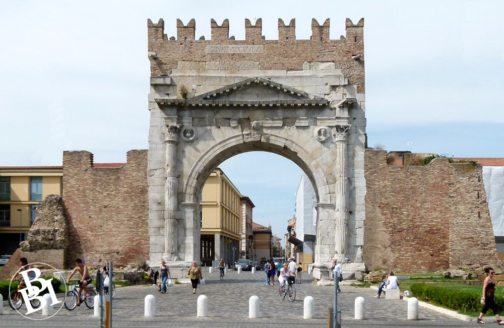 Roman wall and archway of the Arco di Augusto