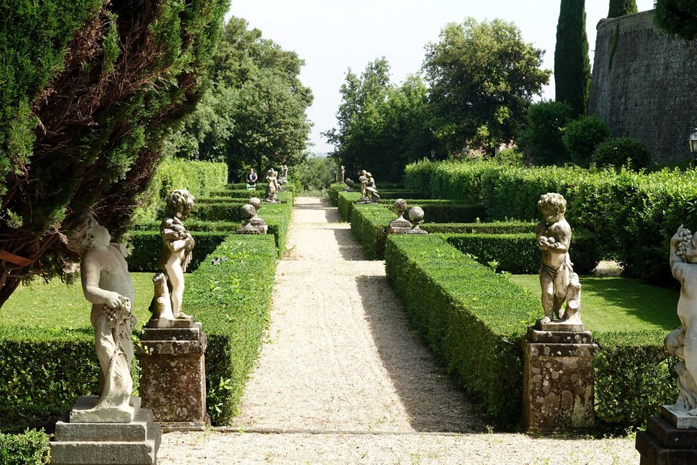 Formal gardens with hedges and statues
