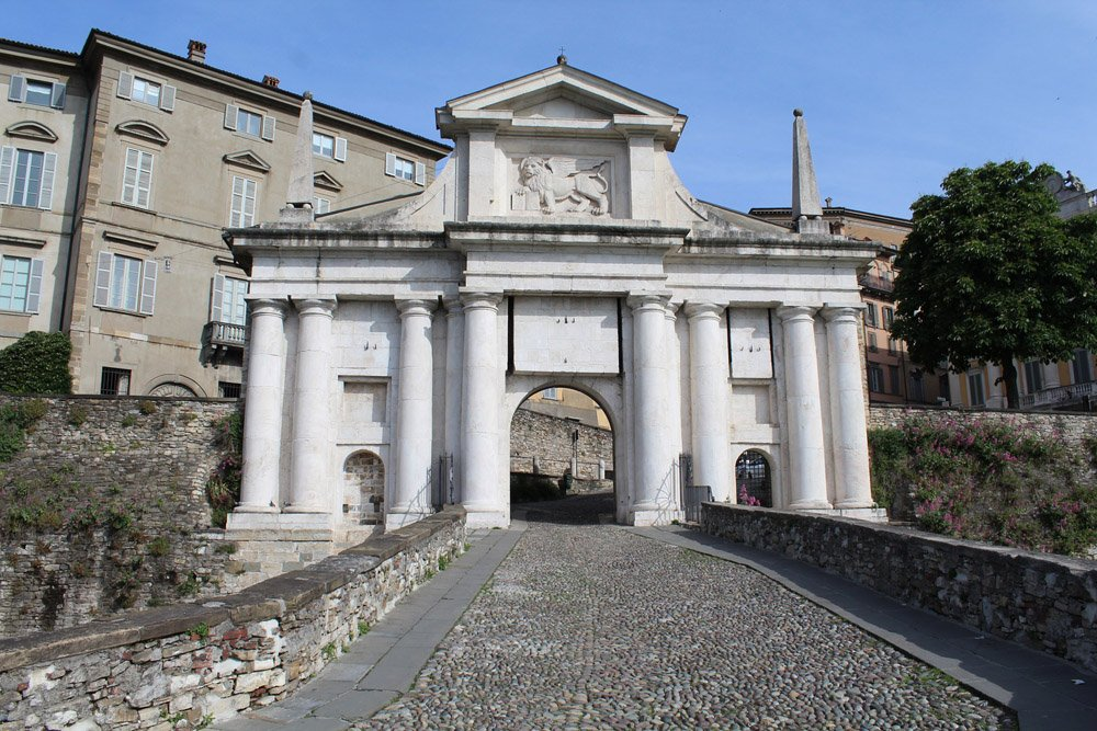 Elaborate gate with eight pillars leading into the city of Bergamo