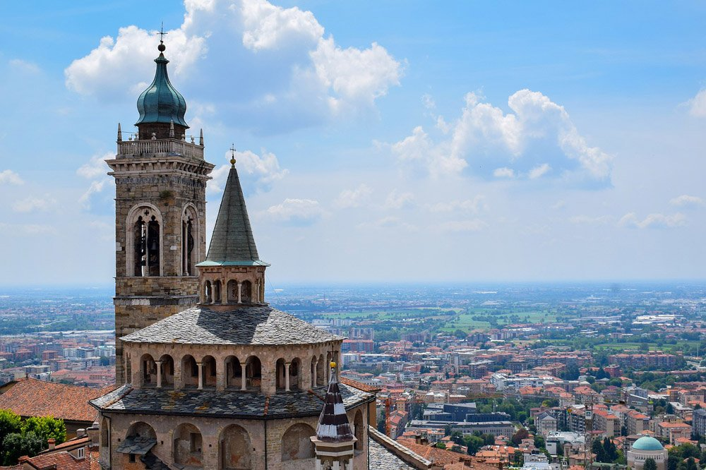 Cathedral dome and tower, with view over town and countryside