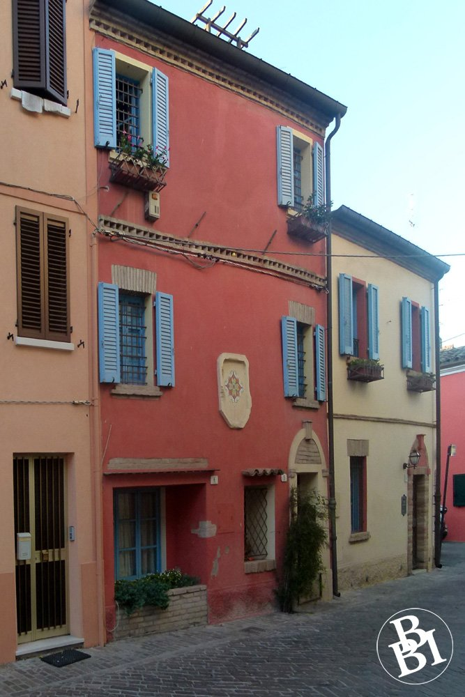 Red painted house in the old quarter of Borgo San Giuliano