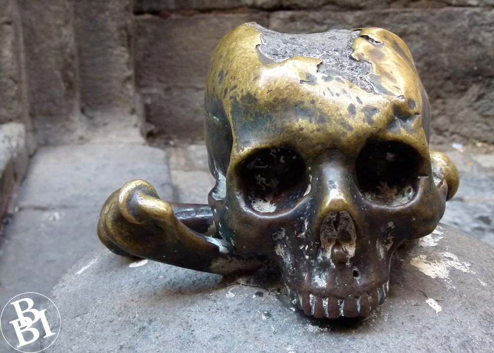 A bronze skull outside the church