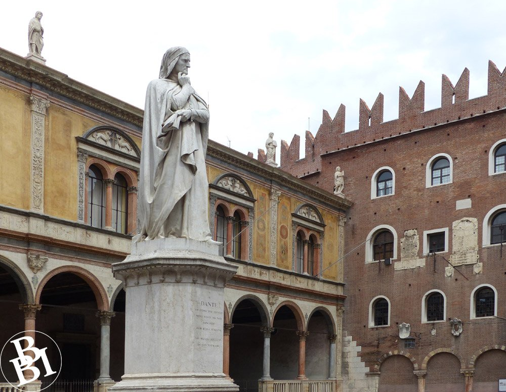 Square with a statue and surrounded by old buildings