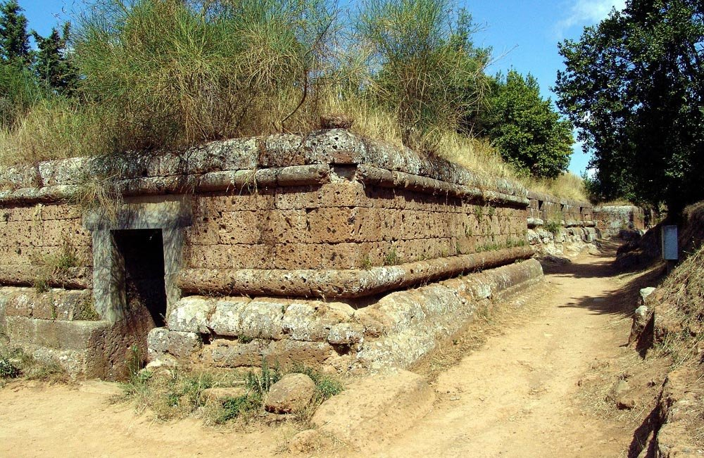 Large brick tomb surrounded by trees