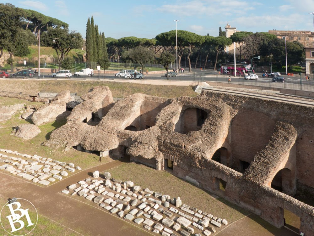 Remains of Roman spectator areas at the Circus Maximus with road and trees in background