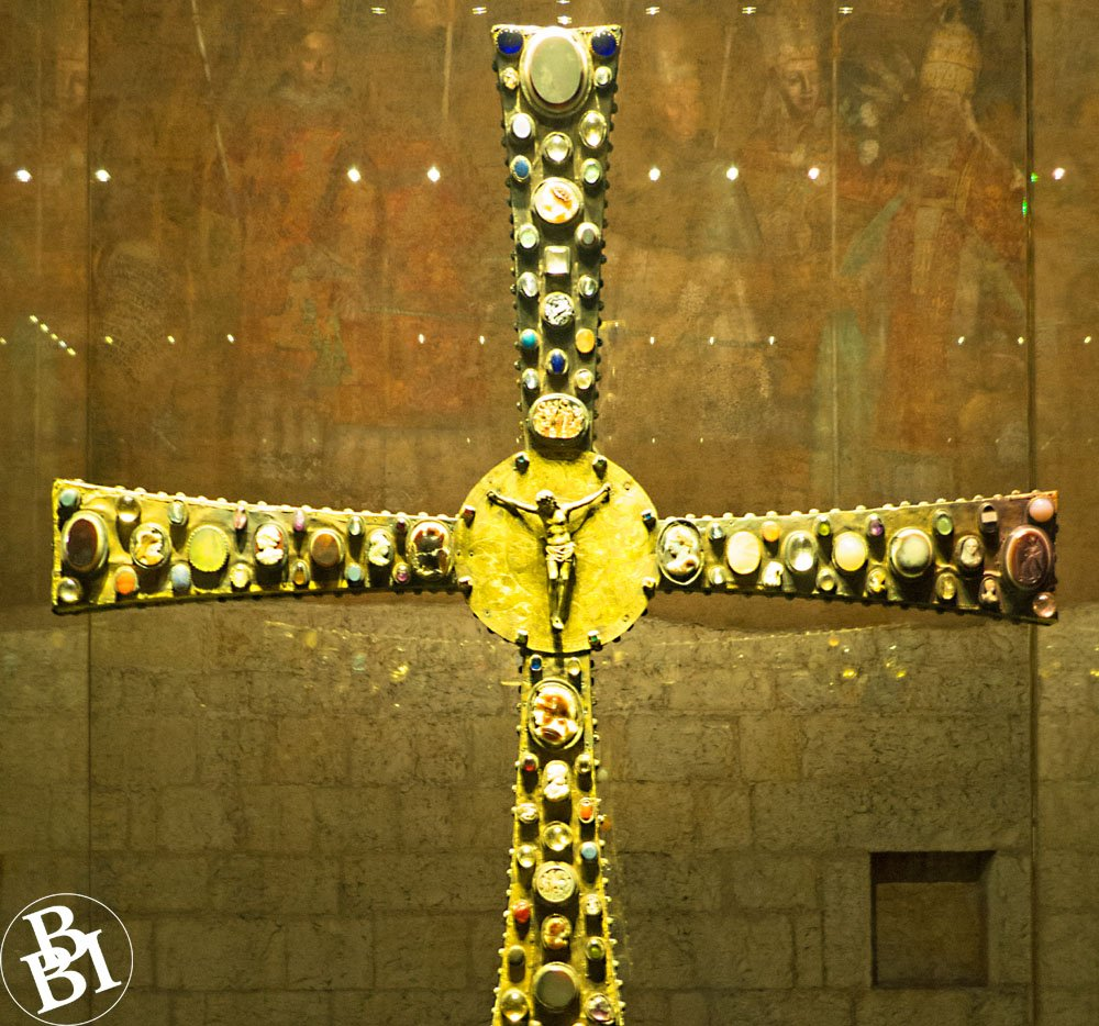 Ornate gold cross studded with jewels