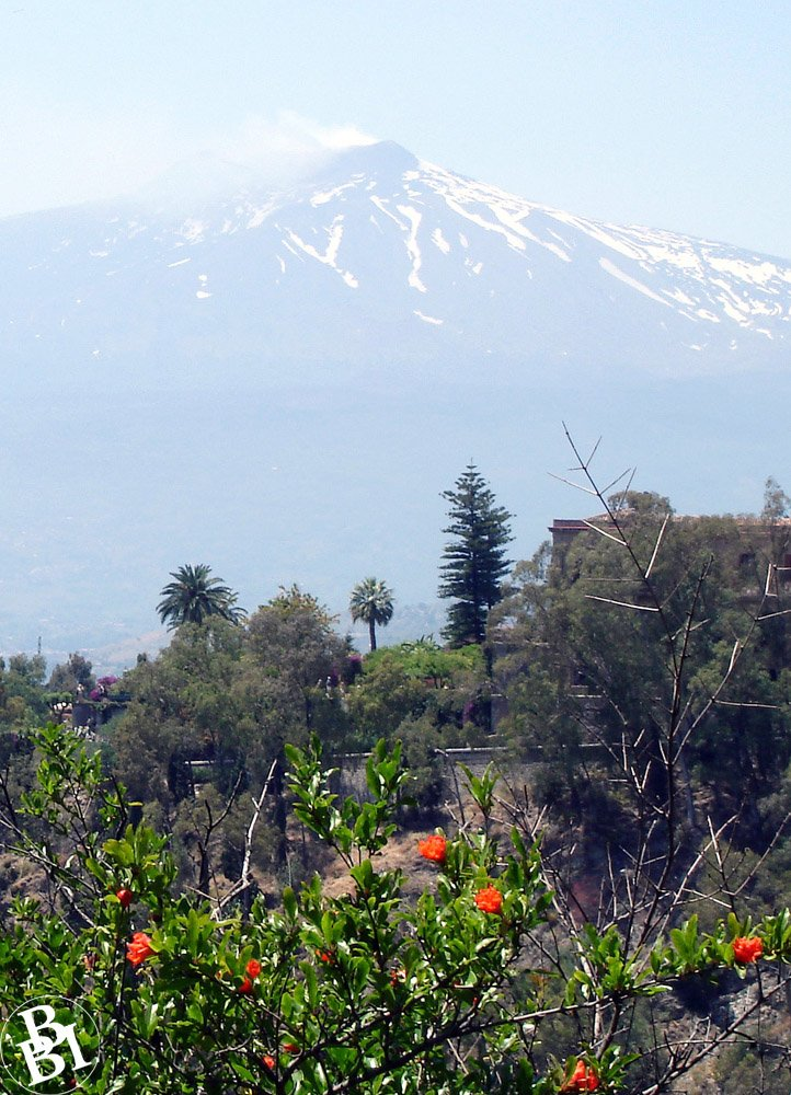 Looking at the snow covered peak of Mount Etna from Taormina