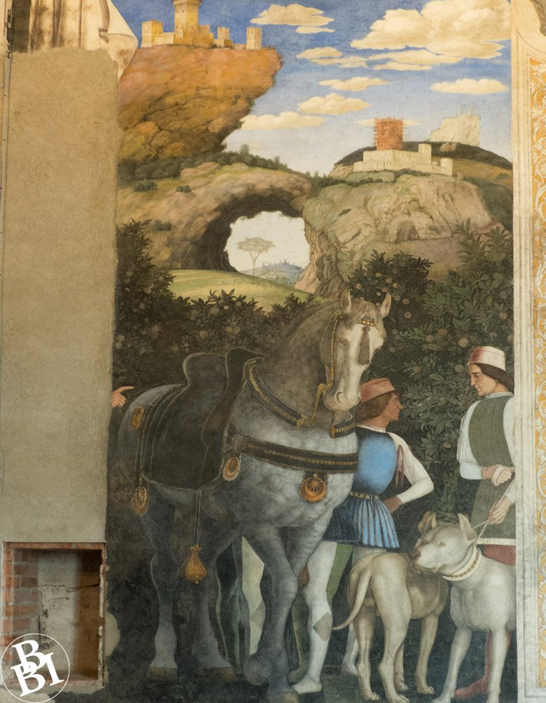 Fresco showing a horse and two men with hills in the distance