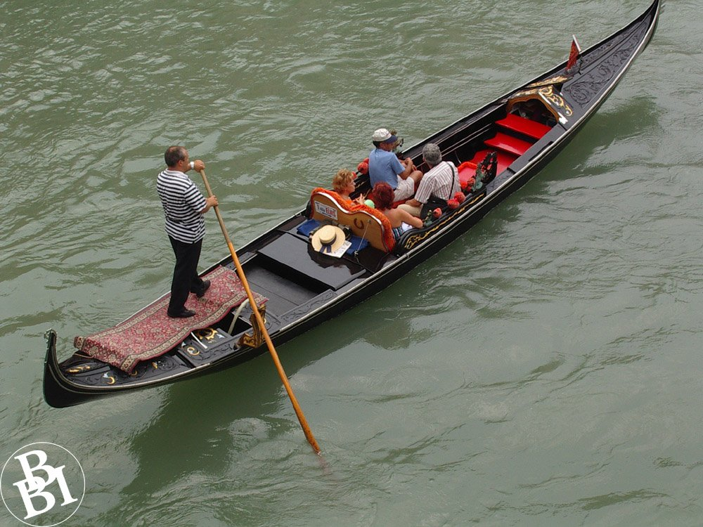 Canal and gondola, with gondolier and passengers