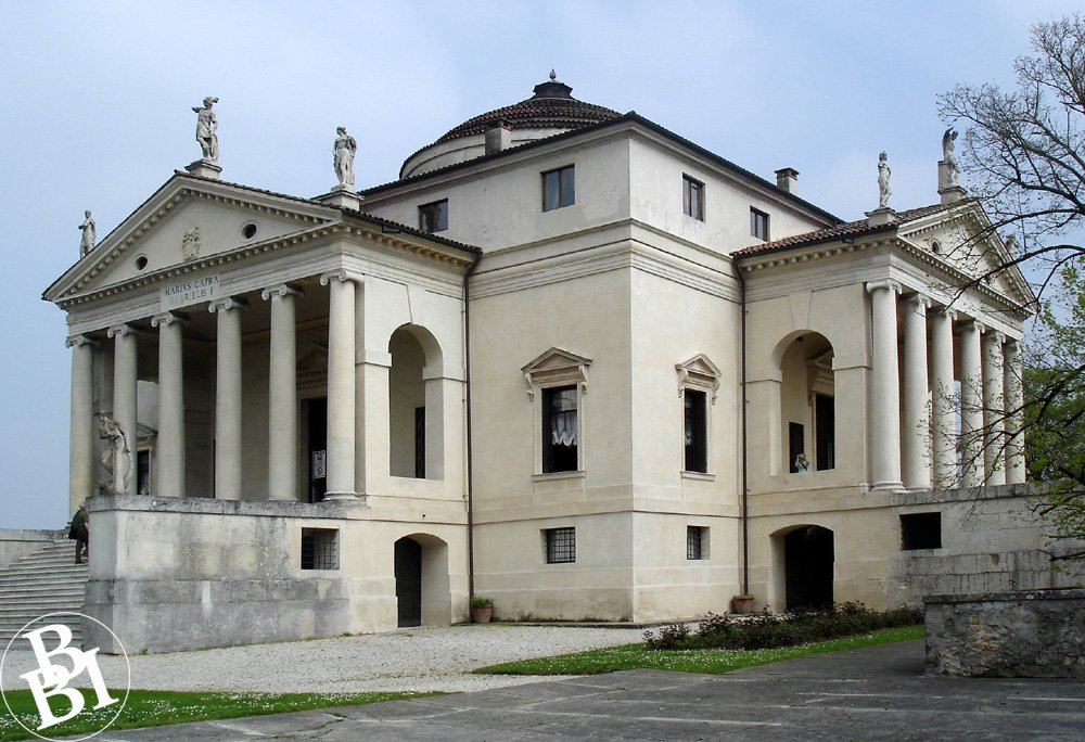 The white exterior of La Rotonda, with its perfect proportions, arches, and statues