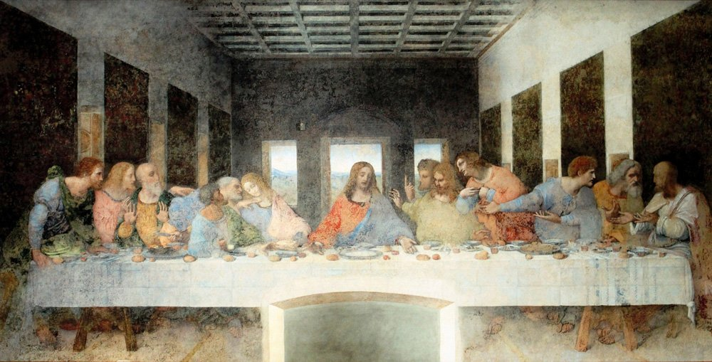 Last Supper painting with Jesus and twelve apostles sitting at a long table
