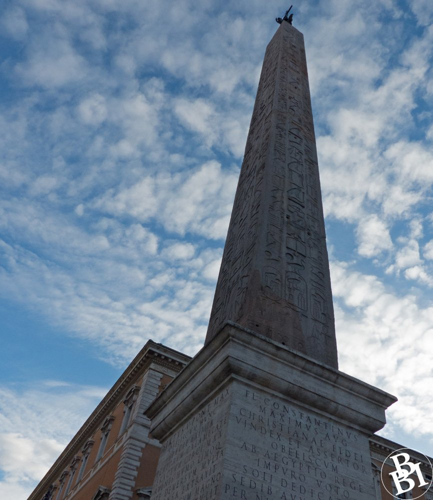 Egyptian obelisk with hieroglyphics and writing in Latin