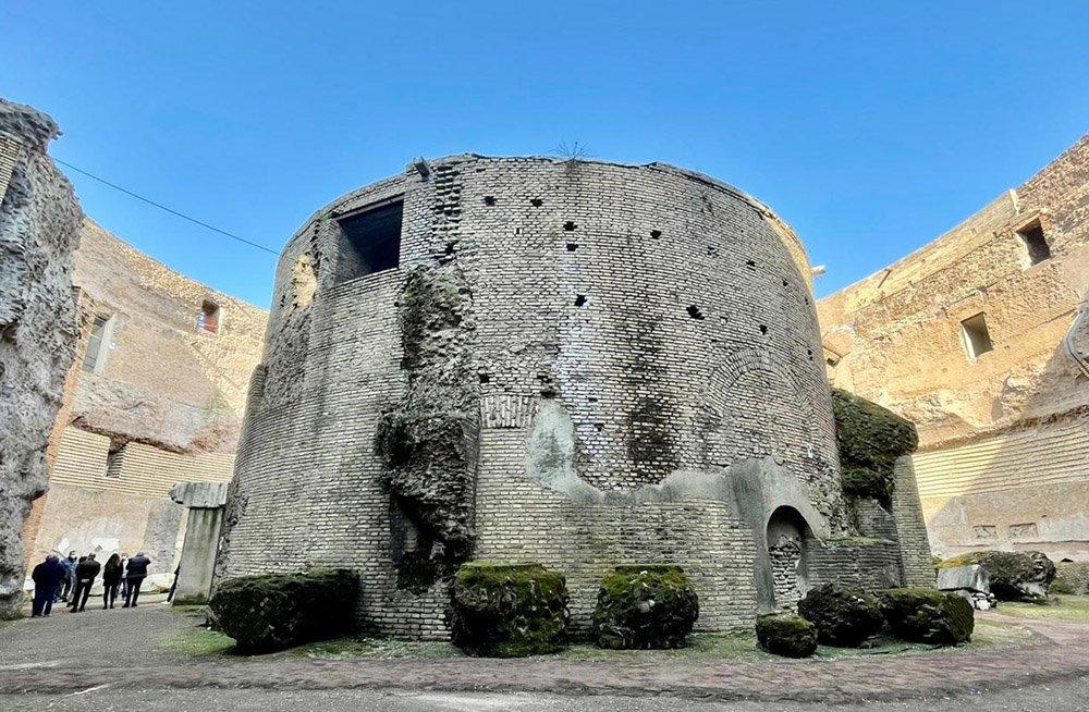Exterior of the mausoleum, a circular grey structure