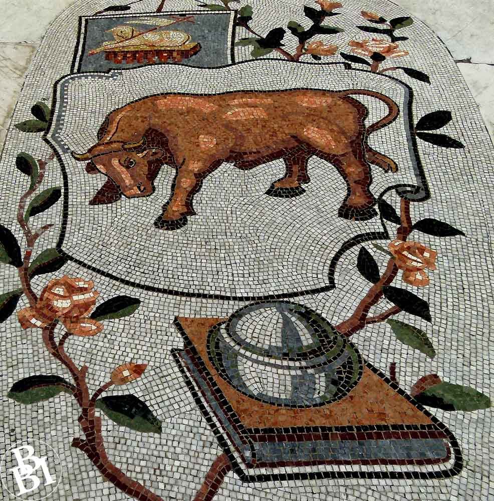 Mosaic of a bull and a book surrounded by flowers