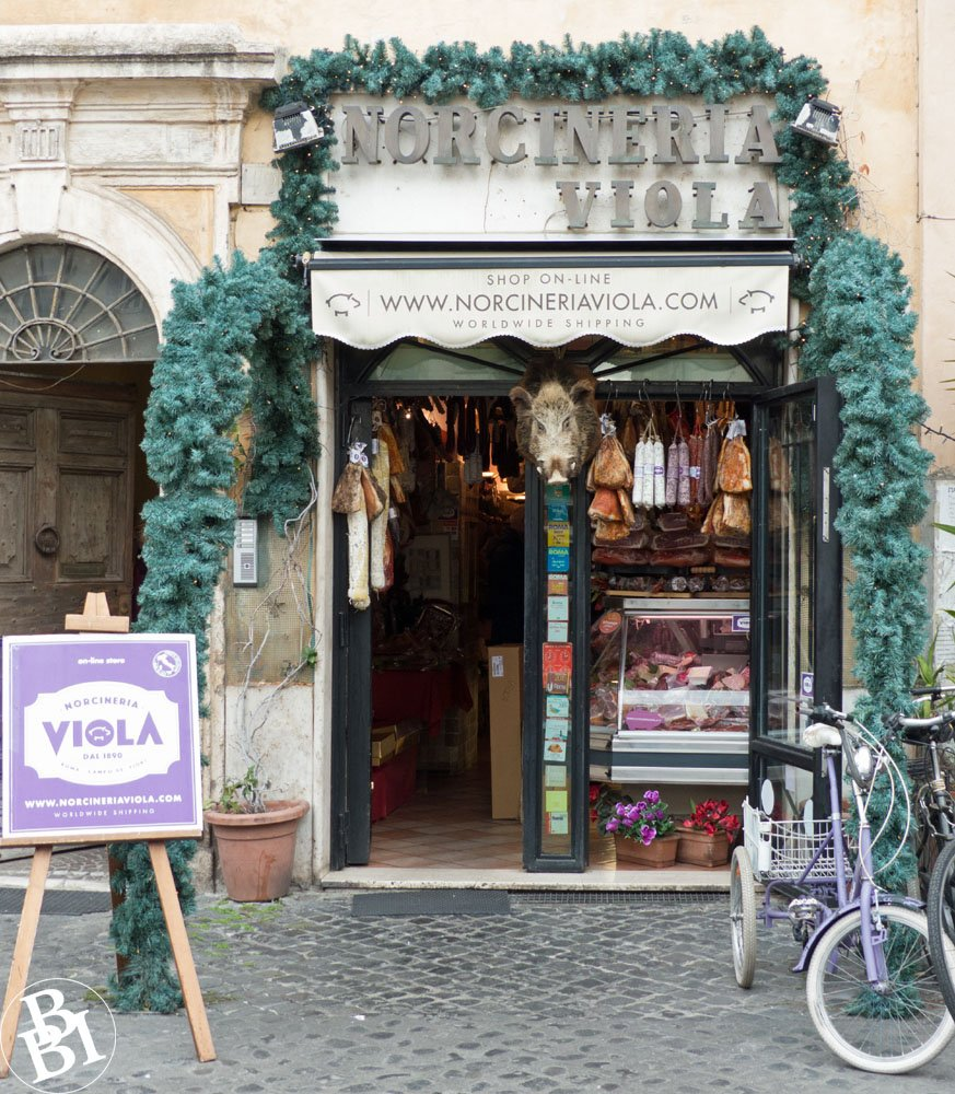 The Norcineria Viola, a typical Roman salumeria with dried meats in the window