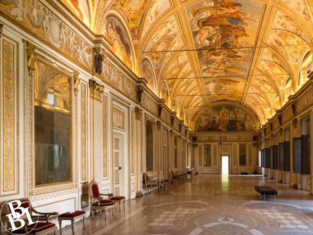 Ornate room in Palazzo Ducale with painted ceiling and patterned floor