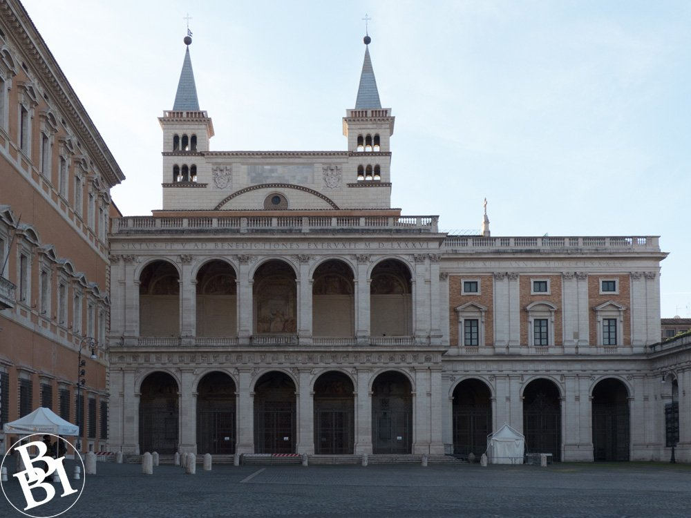 Courtyard and two wings of the Lateran Palace, a building with arches and frescoes