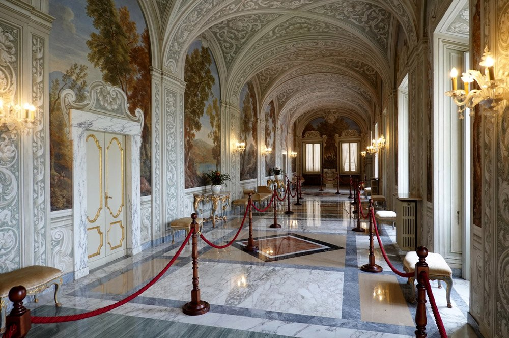 Long room with marble floor and painted walls and ceiling