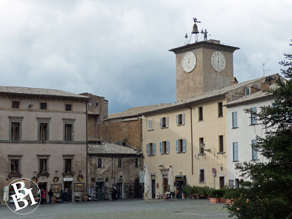 Town square surrounded by buildings and a clock tower