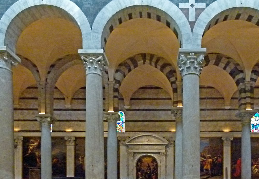 Interior of the cathedral with arches and paintings