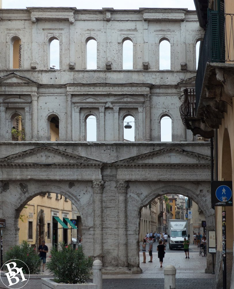 The Roman Porta Borsari, with two large arches and several smaller ones above
