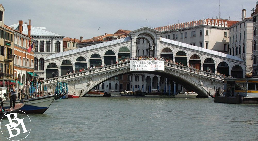 The Rialto Bridge, a covered bridge with archways above a canal