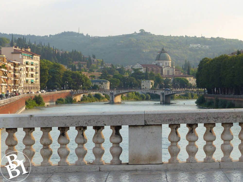 Stone bridge, river and the city of Verona