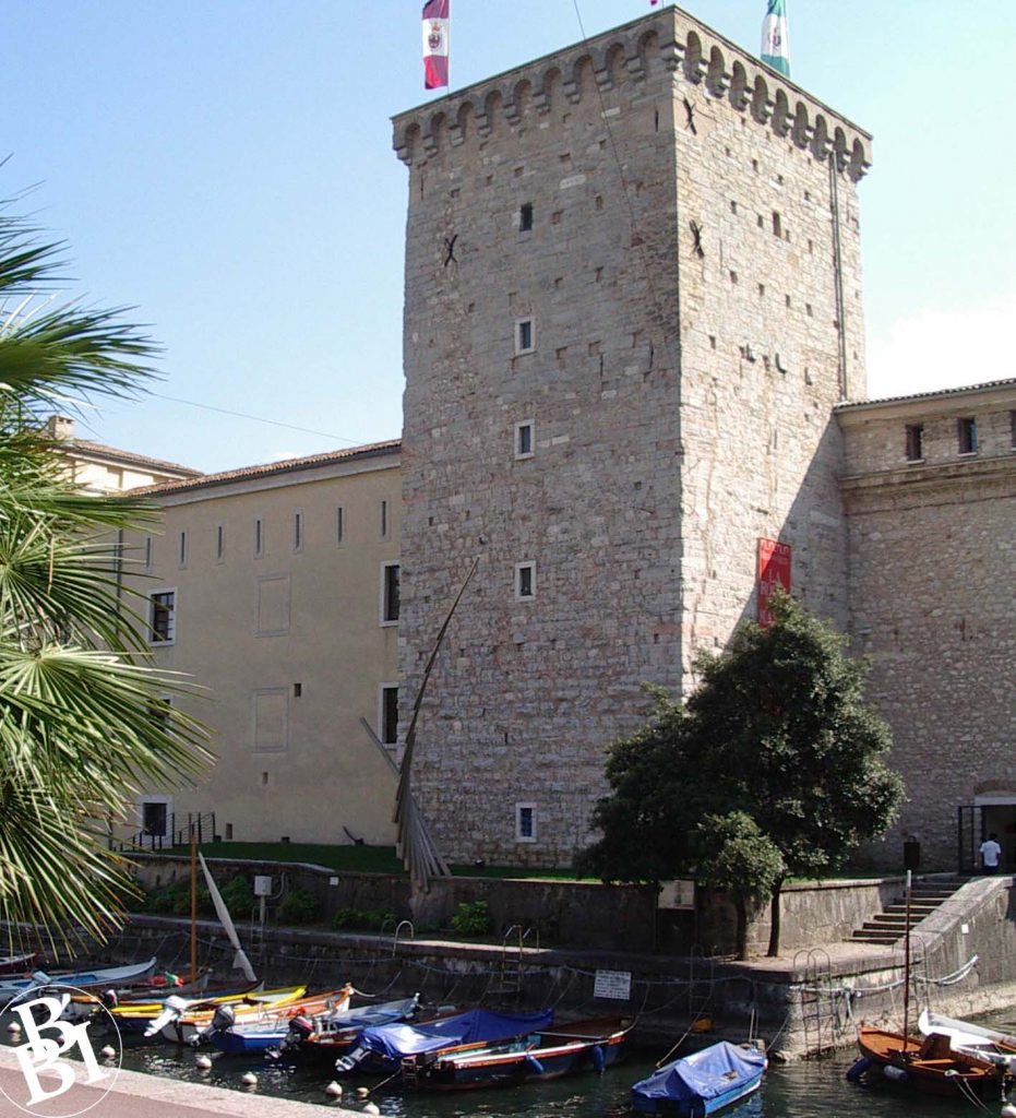 Tower of the Rocca Fortress with moat and boats in front