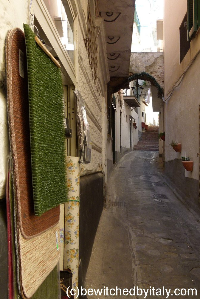 Narrow street with archway at the end