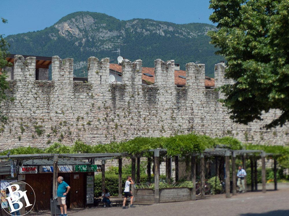 Medieval city wall with mountains in the distance