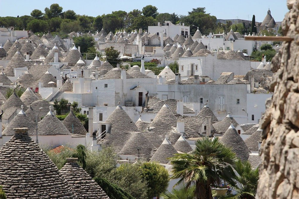 Town full of densely packed white painted houses with conical roofs
