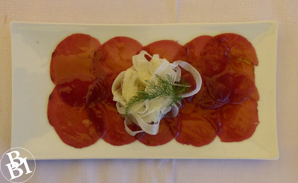 Oblong plate with slices of tuna carpaccio
