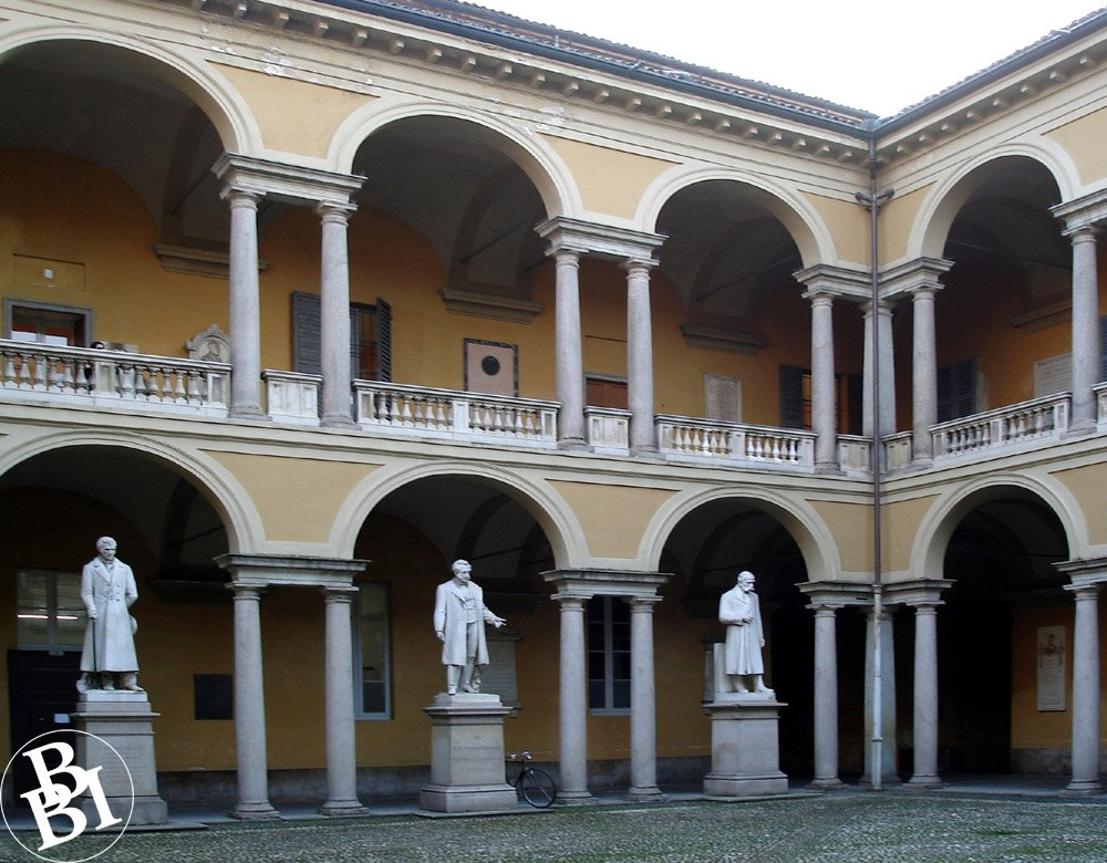 Ornate courtyard with archways and statues