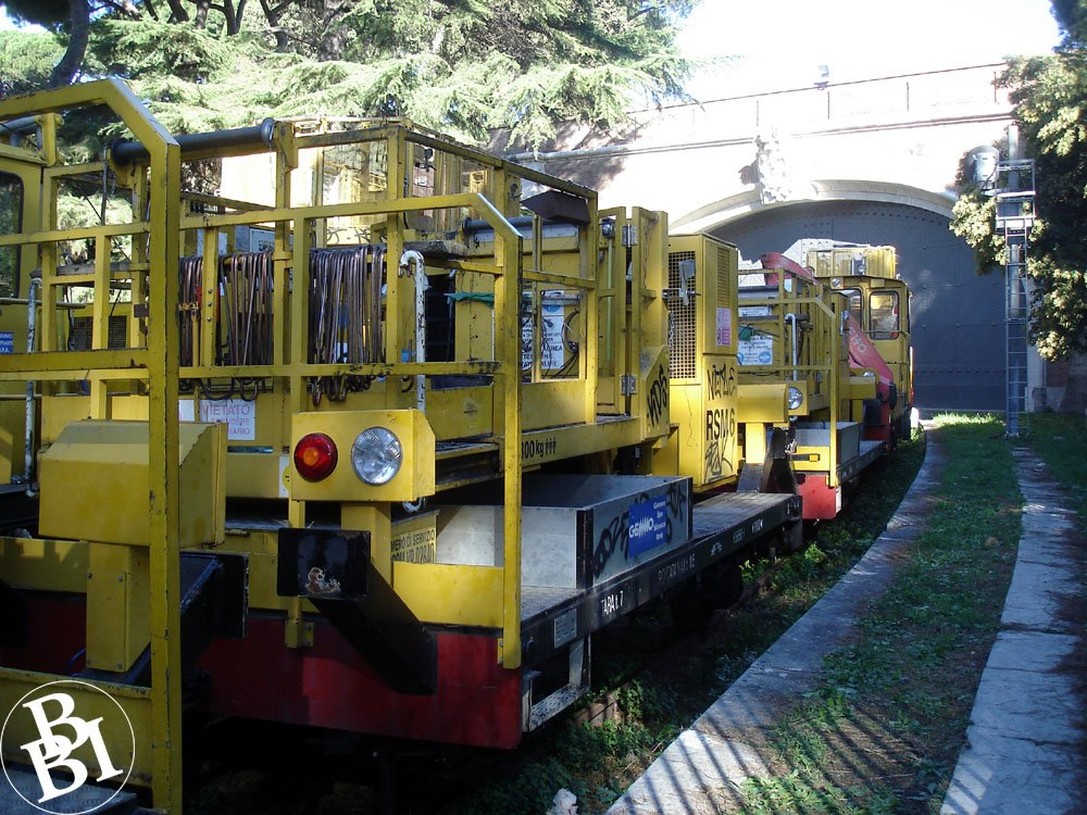 Yellow freight train outside the Vatican walls