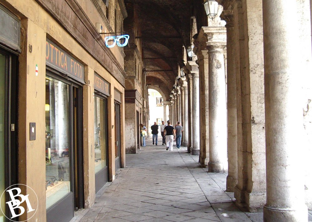 Street arcade with shops and columns