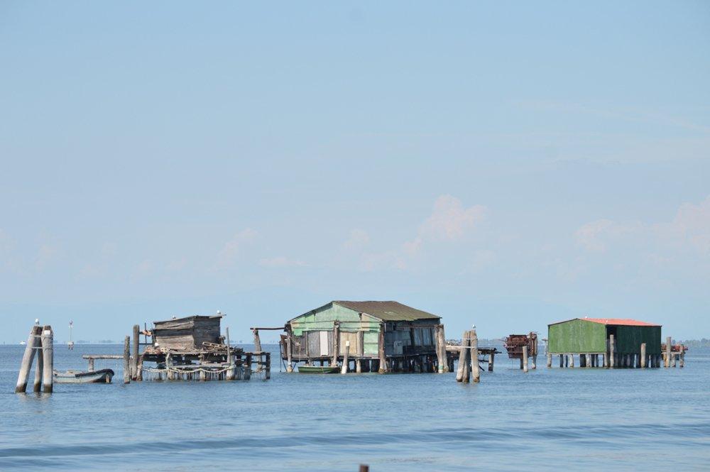 Wooden huts in the sea near Pellestrina